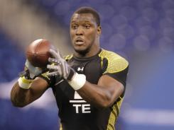 Georgia tight end Orson Charles makes a catch at the NFL football scouting combine in Indianapolis on Feb. 25, 2012.