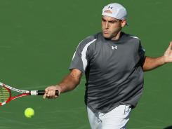 Robby Ginepri became the first American to advance to the second round of the BNP Paribas Open at the Indian Wells Tennis Garden, beating out Paolo Lorenzi of Italy.