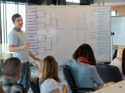 Matt Trogdon, business community connector at Motley Fool, teaches a class on the NCAA tournament to his co-workers Tuesday in Old Town Alexandria, Va.