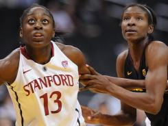 Stanford's Chiney Ogwumike, left, battling for rebound position with Arizona State's Kimberly Brandon, tallied 12 points and 13 rebounds in the Cardinal's 52-43 win.