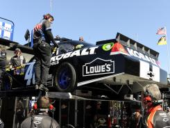 The backup car for Jimmie Johnson is lowered out of the No. 48 hauler Saturday at Las Vegas Motor Speedway.