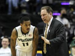 Tom Izzo talks with Keith Appling during Saturday's Big Ten tournament semifinal game. The Spartans won.