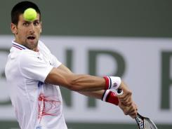 Novak Djokovic returns a shot to Andrey Golubev during their match at the BNP Paribas Open. Djokovic, who won 6-3, 6-2, is the event's defending champion.