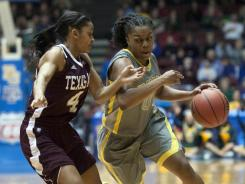 Baylor guard Odyssey Simms, right, driving against Texas A&amp;M guard Sydney Carter, scored a season-high 26 points to help the Lady Bears win the Big 12 tournament title.