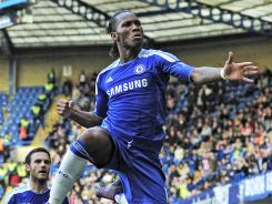 Chelsea striker Didier Drogba celebrates scoring the game-winning goal against Stoke City and his 100th in the English Premier League, in the 68th minute.