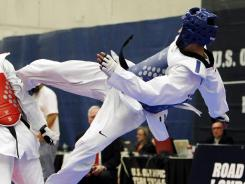 While his siblings Steven and Diana will once again represent the U.S. in taekwondo this summer at the London Games, Mark Lopez, right, fell short of an Olympic bid.