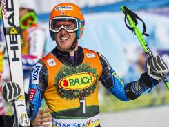 Ted Ligety celebrates after his second run during Saturday's World Cup event. The defending giant slalom chance still has an outside chance at retaining his title.