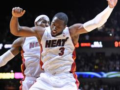Dwyane Wade scored a game-high 28 points, including the winning bucket in the final seconds of overtime.