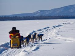 Musher Mitch Seavey, the 2004 Iditarod champion, leaves the Ruby, Alaska, checkpoint on Friday. He's in third place, trailing leader Aliy Zirkle and his son, Dallas, as the race nears the finish.