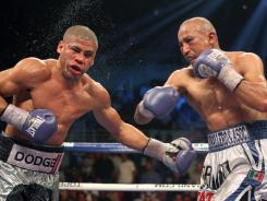 Orlando Salido, right, lands a punch that floored Juan Manuel Lopez in the 10th round Saturday in San Juan.