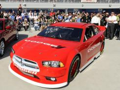 The Dodge Charger that will be used in NASCAR in 2013 was unveiled before fans Sunday at Las Vegas Motor Speedway.