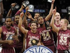 Florida State players celebrate after the school's first ACC tournament title.