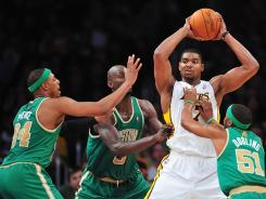 Lakers center Andrew Bynum (17) is surrounded by Celtics defenders during the first half at the Staples Center. Bynum had 20 points and 14 rebounds.
