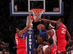 The 76ers hounded Carmelo Anthony, center, and the Knicks the entire game in a 106-94 victory Sunday at Madison Square Garden.