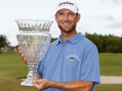 George McNeill holds the trophy after winning the Puerto Rico Open on March 11, 2012 in Rio Grande, Puerto Rico.