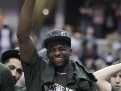 Michigan State forward Draymond Green celebrates after the Spartans beat Ohio State 68-64 in the final of the Big Ten men's tournament in Indianapolis on Sunday.