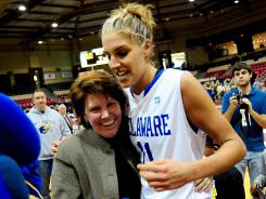 Delaware coach Tina Martin, left, and forward Elena Delle Donne celebrate the first CAA title in school history.