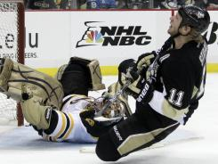 Boston Bruins goalie Marty Turco makes a save on a second-period breakaway by Pittsburgh Penguins' Jordan Staal Sunday.