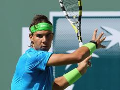 Rafael Nadal of Spain returns a forehand to Leonardo Mayer of Argentina during the BNP Paribas Open in Indian Wells, California. Nadal won the match 6-1, 6-3.