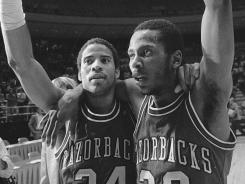 1981 miracle: Arkansas' U.S. Reed, left, and Darrell Walker exult after Reed's shot near halfcourt beat defending champ Louisville.