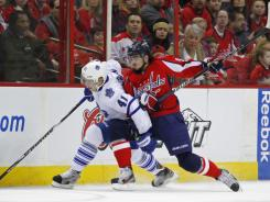 Maple Leafs right wing Nikolai Kulemin (41) battles for the puck with Capitals center Marcus Johansson in the first period of their game on Sunday. Washington won for the third straight time, continuing its up-and-down season.