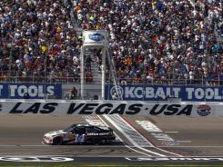 Sprint Cup Series driver Tony Stewart (14) drives past the start finish line during the Kobalt Tools 400 at Las Vegas Motor Speedway. Stewart's first place finish earned him his first Sprint Cup title in Las Vegas.