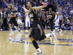 Vanderbilt forward Jeffery Taylor and others celebrate a 71-64 win over Kentucky in the SEC championship game.