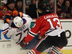 Daniel Carcillo's January hit on Tom Gilbert led to a seven-game suspension and season-ending knee surgery.