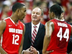 Ohio State coach Thad Matta, center, talks with Sam Thompson.