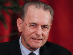 In this file photo from Feb. 15, 2012, International Olympic Committee President Jacques Rogge speaks at the University of Southern California's Annenberg Institute of Sports, Media and Society in Los Angeles.