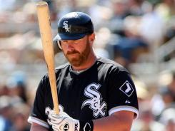 Adam Dunn, batting for the White Sox during a spring game Saturday, is trying to put his woeful 2011 season in the past.