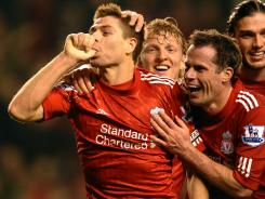Liverpool midfielder Steven Gerrard, left, celebrates after scoring his second goal during Liverpool's 3-0 win over Everton at Anfield in Liverpool, England on Tuesday night.