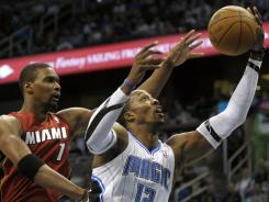 Center Dwight Howard had 24 points and 25 rebounds in the Magic's 104-98 victory over the Miami Heat on Tuesday in Orlando.
