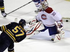 Buffalo Sabres defenseman Tyler Myers scores the game-winning goal on Montreal Canadiens goalie Peter Budaj Monday night.