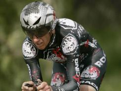 U.S. cyclist Tyler Hamilton competes in the individual time trial of the Tour of California cycling race in Solvang, Calif., on Feb. 20, 2009. The International Olympic Committee (IOC) is investigating whether to strip Hamilton of his gold medal in the 2004 Athens Olympics following his admission of doping.