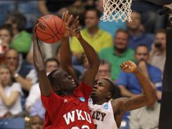 Western Kentucky's Teeng Akol goes up for a shot over MVSU's Cor-J Cox in the second half of Tuesday's game.