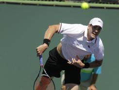 The USA's John Isner, above, served up a victory against Matthew Ebden of Australia on Wednesday in the BNP Paribas Open.