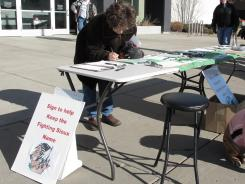 An unidentified North Dakota voter signs the petition seeking to force the University of North Dakota to keep its controversial Fighting Sioux nickname. The effort drew more than enough valid signatures to put the issue on the ballot in June.