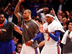 The Knicks celebrate from the bench during their 121-79 victory against the Trail Blazers on Wednesday night. Earlier in the day, Mike D'Antoni resigned as New York's coach.