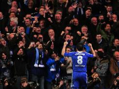 Chelsea midfielder Frank Lampard celebrates after scoring during the UEFA Champions League match against Napoli at Stamford Bridge Stadium in London. Chelsea and Real Madrid advanced to the quarterfinals.