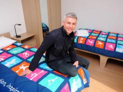 Former Olympic athlete Jonathan Edwards, who is now Chair of the London Organizing Committee of the Olympic Games' Athletes Committee, is pictured in a completed apartment bedroom in the Athlete's Village at the Olympic Park in Stratford on March 15.