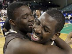 Youssou Ndoye (left) and Atlantic 10 player of the year Andrew Nicholson hope to continue the Bonnies' celebration in the NCAA tournament.