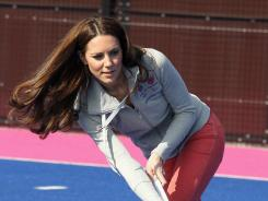 Britain's Catherine, Duchess of Cambridge, hits the ball as she plays with the British Olympic women's field hockey team during a visit to the Olympic Park in London on March 15.