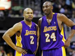 The Los Angeles Lakers broke up their longtime backcourt Thursday when they sent point guard Derek Fisher, left, to the Houston Rockets. He will face his former teammate Kobe Bryant, right, when the teams play in Houston on Tuesday.
