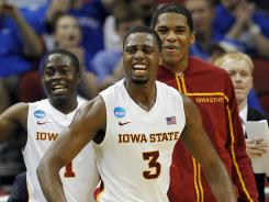 Iowa State forward Melvin Ejim (3) and guard Bubu Palo, left, react with teammates after a 3-pointer against Connecticut in the first half of Thursday's game.