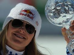 Lindsey Vonn holds the super-G World Cup trophy on March 15 after the women's Alpine skiing World Cup Super G finals in Schladming.
