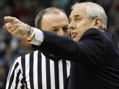 North Carolina-Asheville coach Eddie Biedenbach appeals to an official during the second half in the Bulldogs' loss to top-seeded Syracuse.