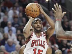 Chicago John Lucas III had 24 points to help the Bulls defeat the Miami Heat, 106-102, on Wednesday night at Chicago.