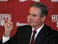 Mississippi State head basketball Coach Rick Stansbury gestures during a news conference where he announced he is retiring after 14 seasons.