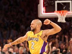 Guard Derek Fisher in better times, celebrating the Los Angeles Lakers' 2010 NBA championship vs. the Boston Celtics, his fifth title. The Lakers dealt Fisher on Thursday to the Houston Rockets, who will buy him out after he failed to report.